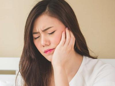 Triệu chứng sau niềng răng